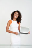 Woman showing laptop. Cheerful Vietnamese young woman showing laptop in her hands, isolated on white Royalty Free Stock Photography