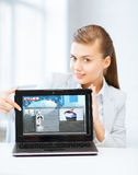 Woman showing laptop pc with news. Business, technology, internet and news concept - women showing laptop pc with news app stock photography