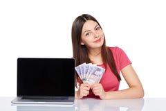 Woman showing laptop screen royalty free stock photo