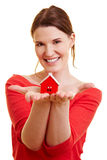 Woman showing little house stock image