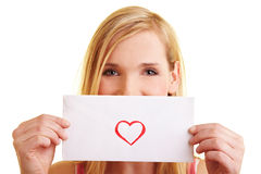 Woman showing a love letter Royalty Free Stock Images