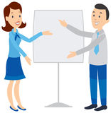 Woman showing man a large document. Royalty Free Stock Photo