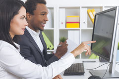 Woman showing, man taking notes stock images