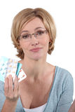 Woman showing medication Royalty Free Stock Images
