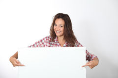 Woman showing message board Royalty Free Stock Photo