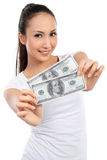 Woman showing  money Stock Images