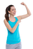 Woman showing muscle Royalty Free Stock Photography