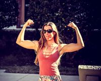 Woman Showing Muscles Royalty Free Stock Photos