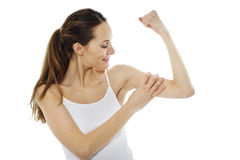 Woman showing muscles Stock Photos