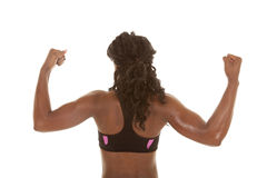 Woman showing muscles back Royalty Free Stock Photo
