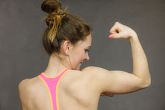 Woman showing muscles of the back and shoulders Stock Photos