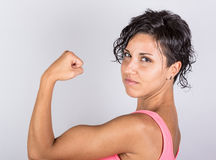 Woman showing Muscles Stock Image