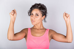 Woman showing Muscles Royalty Free Stock Images