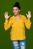 Woman showing nine fingers Stock Photo