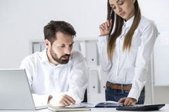 Woman showing notes to her boss Royalty Free Stock Photography