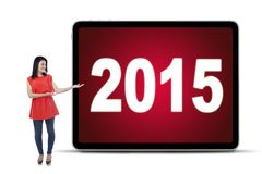Woman showing numbers 2015 on billboard Stock Photos