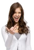 Woman showing obscene gesture Stock Photography