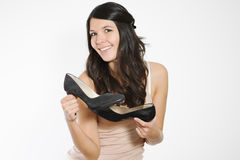 Woman showing off classic black court shoes stock photos