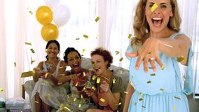 Woman showing off her engagement ring. Digital composite of a Caucasian woman showing off her engagement ring with diverse friends sitting in the background and stock footage