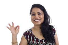 Woman showing ok hand sign for perfection Stock Photography