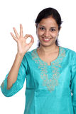 Woman showing OK sign Stock Images