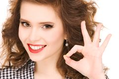 Woman showing ok sign Stock Photography