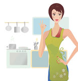 Woman Showing Ok Sign. Girl Cooking in Her Kitchen Stock Image