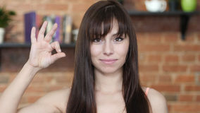 Woman Showing Ok Sign, Indoor Royalty Free Stock Photo