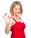 Woman is showing OK sign Stock Photos