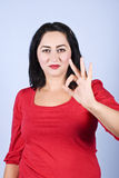 Woman showing okay sign Stock Photography