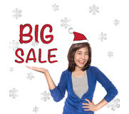 Woman showing open hand palm with red big sale text. Royalty Free Stock Photography