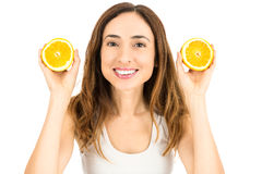 Woman showing orange halves. Smiling attractive caucasian woman showing orange halves. Isolated on white background royalty free stock image