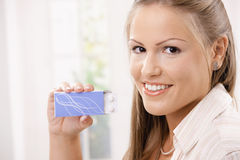 Woman showing package of pills Royalty Free Stock Photos