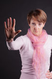 Woman showing palm of hand Stock Photography