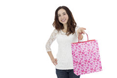 Woman showing a paper gift bag Stock Photography