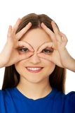 Woman showing perfect sign on eyes. Stock Photography