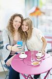 Woman showing phone to friend Royalty Free Stock Image