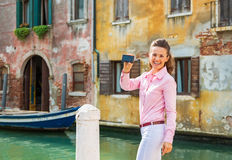 Woman showing photo camera while in venice, italy Royalty Free Stock Photos