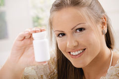 Woman showing pill bottle Royalty Free Stock Image