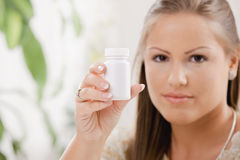Woman showing pill bottle Royalty Free Stock Images