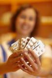 Woman showing pills Stock Photos