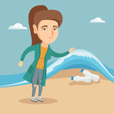 Woman showing plastic bottles under sea water. Royalty Free Stock Photo