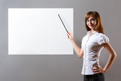 Woman showing with pointer to blank placard Royalty Free Stock Images