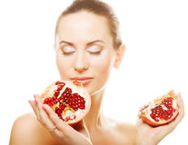 Woman showing pomegranate smiling. Stock Photography