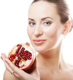 Woman showing pomegranate smiling. Stock Images