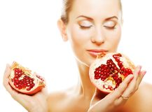 Woman showing pomegranate smiling. Stock Photos