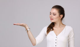 Woman showing a product. Empty copy space on the open hand palm. Stock Photo