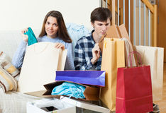 Woman showing purchases  to boyfriend Stock Image