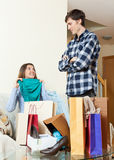Woman showing purchases to boyfriend Stock Images