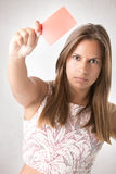 Woman Showing Red Card Stock Image